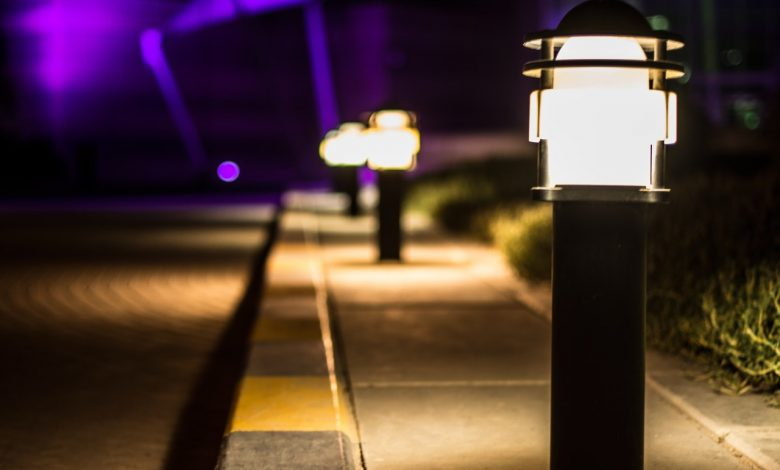 What are the benefits of using solar lights in outdoor premises?
